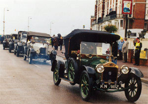 Vintage vehicles line up for a parade
